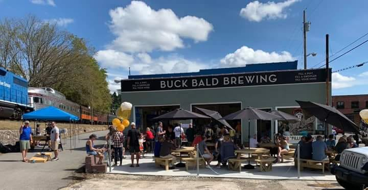 Buck Bald Brewing and train with visitors enjoying brews