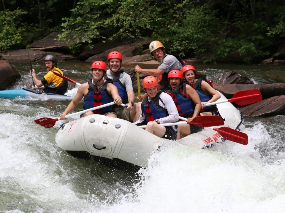 Smiling rafters paddling Double Trouble on the Ocoee River